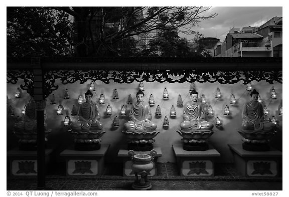 Buddha images at dusk, Viet Nam Quoc Tu pagoda. Ho Chi Minh City, Vietnam (black and white)