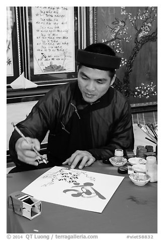 Caligrapher in traditional costume. Ho Chi Minh City, Vietnam (black and white)