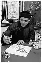 Caligrapher in traditional costume. Ho Chi Minh City, Vietnam ( black and white)