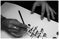 Feminine hand draws Lunar New Year greetings in fancy writing. Ho Chi Minh City, Vietnam ( black and white)
