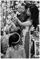 Woman and children in traditional dress for lunar new year. Ho Chi Minh City, Vietnam ( black and white)
