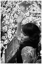 Woman next to Tet (Lunar New Year) decorations. Ho Chi Minh City, Vietnam ( black and white)