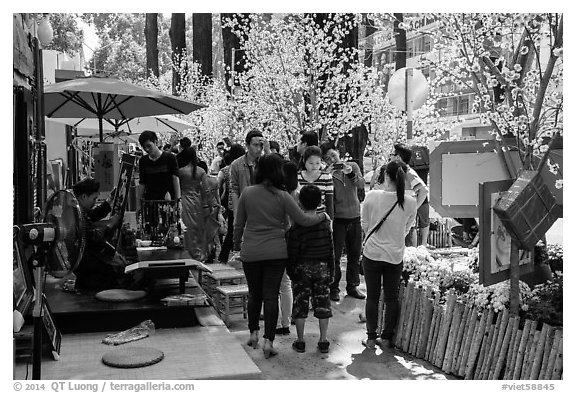 Sidewalk with Lunar New Year decorations and booths. Ho Chi Minh City, Vietnam (black and white)