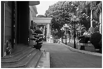Photograph and tank that crashed through presidential palace. Ho Chi Minh City, Vietnam ( black and white)
