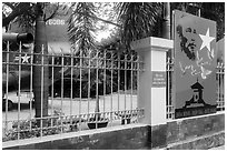 US Helicopter tail and fence with poster, War Remnants Museum, district 3. Ho Chi Minh City, Vietnam ( black and white)