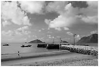 Beach with woman exercising, Con Son. Con Dao Islands, Vietnam ( black and white)