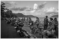 Food vendors on seafront promenade, Con Son. Con Dao Islands, Vietnam ( black and white)