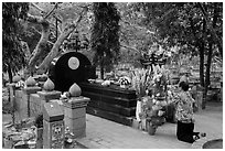 Woman pays respect to Vo Thi Sau grave. Con Dao Islands, Vietnam ( black and white)