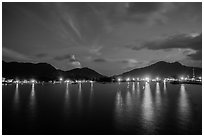 Lights of Con Son reflected in harbor at dawn. Con Dao Islands, Vietnam ( black and white)