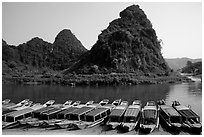 Tour boats and forest-covered limestone rocks, Son Trach. Vietnam ( black and white)