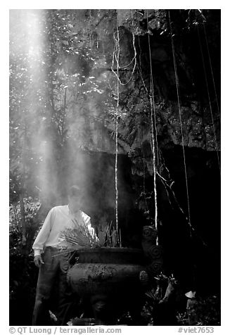 Urn and incense near the entrance of Phong Nha Cave. Vietnam (black and white)