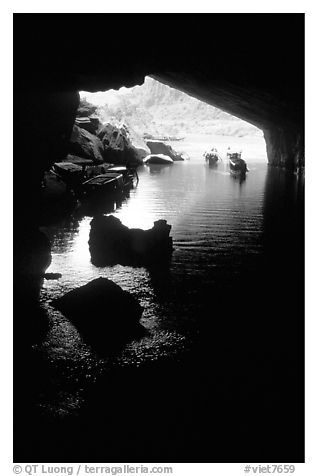 Interior and entrance of Phong Nha Cave with Rocks and boats. Vietnam (black and white)