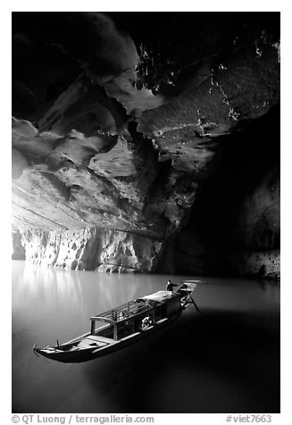 Boat inside the lower cave, Phong Nha Cave. Vietnam (black and white)