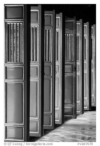 Red doors of the temple inside the Minh Mang Mausoleum. Hue, Vietnam (black and white)