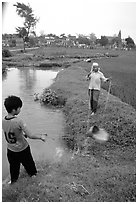 Field irrigation with a swinging bucket. Vietnam ( black and white)