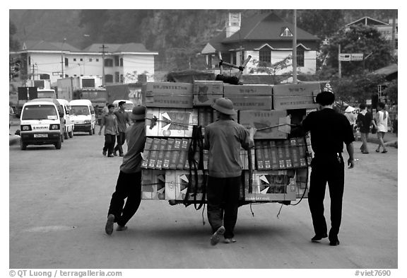 Bicyle loaded with an incredible amounts of goods from China at Dong Dang. Lang Son, Northest Vietnam (black and white)