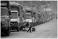 Trucks waiting to cross the border into China at Dong Dang. Lang Son, Northest Vietnam (black and white)