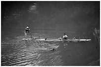 Crossing the Ky Cung  River on a narrow dugout boat. Northest Vietnam ( black and white)