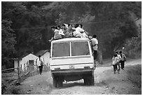 Passengers sitting on top of an overloaded bus. Northest Vietnam ( black and white)