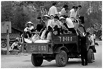 Riding in the back of an overloaded truck. Northest Vietnam ( black and white)