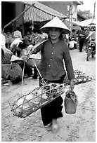 Woman carrying two live pigs, That Khe market. Northest Vietnam (black and white)