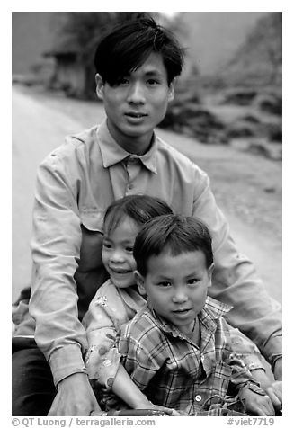 Young man carrying two kids on his bicycle. Northeast Vietnam (black and white)