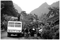 Unloading of a bus in a mountain village. Northeast Vietnam (black and white)