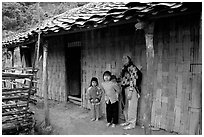 Family outside their home. Northeast Vietnam (black and white)