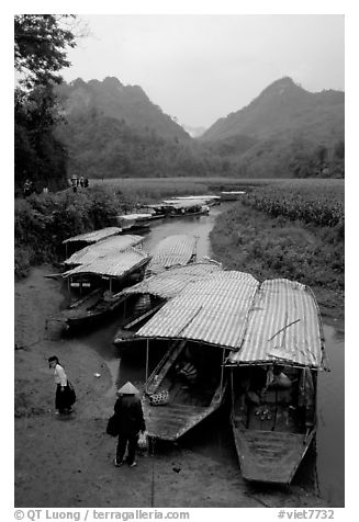 Boats waiting for villagers at a market. Northeast Vietnam (black and white)