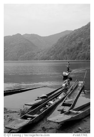 Typical dugout boats on the shore of Ba Be Lake. Northeast Vietnam (black and white)