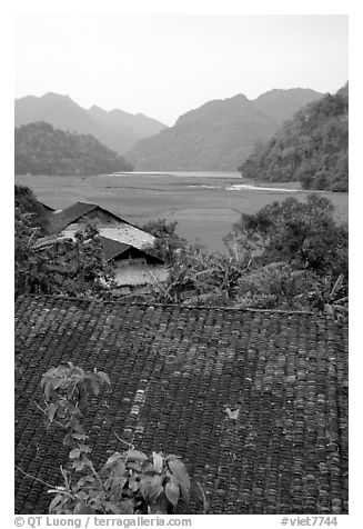 Thatched Roofs of Pac Ngoi village and fields. Northeast Vietnam (black and white)