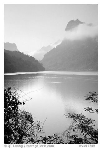 Morning mist on the tall cliffs surrounding Ba Be Lake. Northeast Vietnam (black and white)