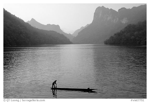 Fisherman on Dugout boat,  Ba Be Lake. Northeast Vietnam (black and white)