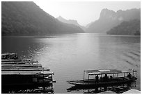 Boats on the shores of Ba Be Lake. Northeast Vietnam (black and white)
