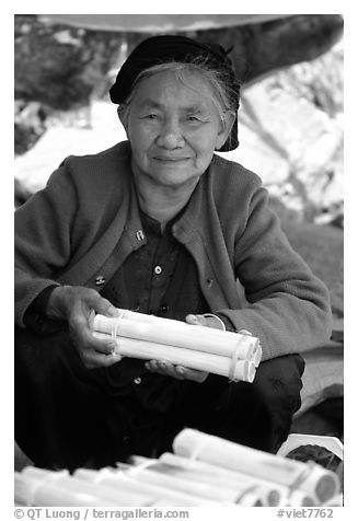 Woman selling sweet rice cooked in bamboo tubes. Vietnam (black and white)