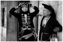 Two generations of tribewomen outside their house, near Mai Chau. Northwest Vietnam (black and white)
