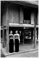 Two thai women standing in front of their stilt house, Ban Lac village. Northwest Vietnam ( black and white)