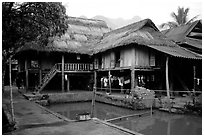 Stilt houses with thatched roofs of Ban Lac village. Northwest Vietnam ( black and white)