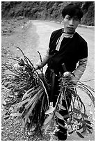 Man of Hmong ethnicity selling wild orchids, near Moc Chau. Vietnam (black and white)
