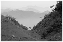 House and misty ridges between Moc Chau and Yeu Chau. Northwest Vietnam (black and white)