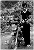Hmong motorcyclist and boy, Xa Linh. Northwest Vietnam (black and white)