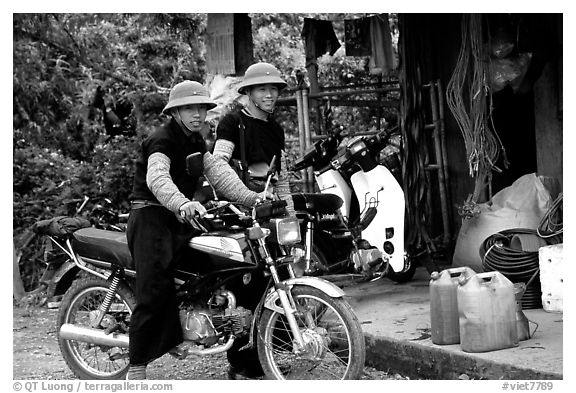 Two Hmong motorcyclists at the Xa Linh market. Northwest Vietnam (black and white)