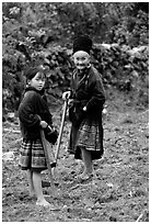 Elderly tribeswoman and girl doing field work  near Yen Chau. Northwest Vietnam ( black and white)
