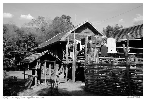 Woman drying laundry in a montagnard village near Son La. Northwest Vietnam (black and white)