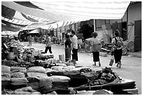 Thai women walk in a town market, near Son La. Northwest Vietnam (black and white)