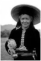Thai woman wearing her traditional dress under the Vietnamese conical hat, near Son La. Northwest Vietnam (black and white)