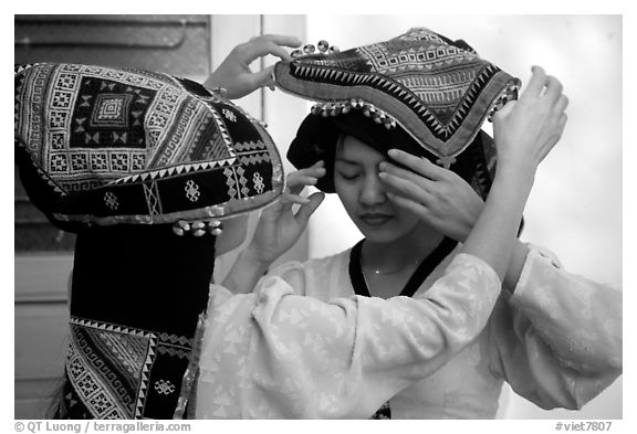 A thai woman helps her friend with her elaborate headdress, Son La. Northwest Vietnam (black and white)