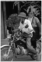 Dzao woman riding at the back of a motorbike, Tuan Giao. Northwest Vietnam (black and white)