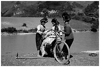 Thai women loading a bicycle, near Tuan Giao. Northwest Vietnam ( black and white)