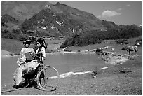 Thai women load a bicycle, near Tuan Giao. Northwest Vietnam ( black and white)